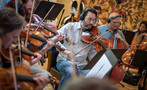 The violins and violas performing on <em>House of Cards</em>