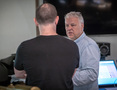 Scoring mixer Peter Cobbin (right) and recording mixer Adam Michalak discuss planning for the scoring sessions