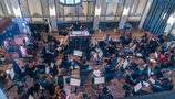 The orchestra records a cue with conductor Lucas Richman