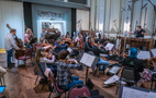 The orchestra performs with conductor Lucas Richman