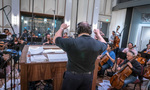 Lucas Richman conducts the orchestra