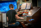 Organist Mark Herman performs with the playback