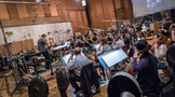 Orchestrator Nolan Livesay conducts the orchestra during the sessions for <i>Maze Runner: The Death Cure</i>