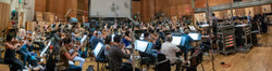 The orchestra records a cue for <i>The Predator</i> with conductor Gavin Greenaway