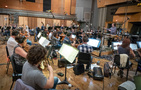 The strings record a cue with conductor Gavin Greenaway