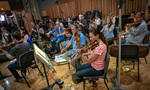 The strings record a cue