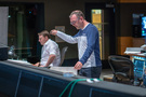 Composer Henry Jackman goes over a cue with orchestrator Stephen Coleman (left)
