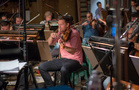 A violist performs on <i>Rampage</i>