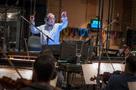 Conductor/orchestrator Nicholas Dodd leads the orchestra