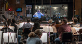 Conductor/orchestrator Nicholas Dodd and the orchestra record a cue