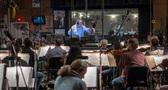 Conductor/orchestrator Nicholas Dodd and the orchestra record a cue