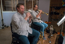 Rob Schaer and Dan Rosenboom perform on trumpet