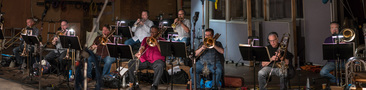 The brass section records a cue