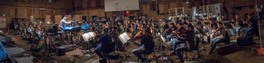 Conductor/orchestrator Nicholas Dodd performs with the low strings ensemble for <i>Rampage</i>