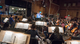Orchestrator Nicholas Dodd conducts the Hollywood Studio Symphony as they perform composer Andrew Lockington's score for <i>Rampage</i>