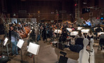 Orchestrator Nicholas Dodd conducts the low string session