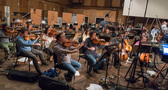 Viola and cello sections perform on the low strings session
