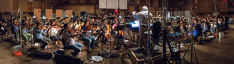 Conductor/orchestrator Nicholas Dodd record a cue with the low strings