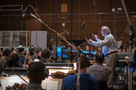 Conductor/orchestrator Nicholas Dodd and the low strings perform