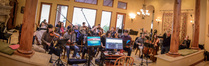 Jeff Beal conducts an ensemble of the Hollywood Studio Symphony strings at his home