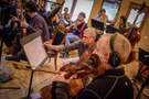 Cellist Dennis Karmazyn makes a note to the music