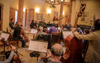 Jeff Beal talks with the musicians at his recording session for <em>Shock and Awe</em>