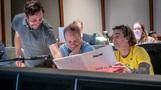 Scoring mixer Greg Hayes, director Karey Kirkpatrick and composer Heitor Pereira examine a cue