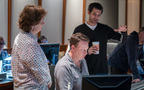 Composer Ramin Djawadi (right) discusses a cue with concertmaster Belinda Broughton and orchestrator Stephen Coleman