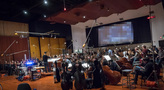 Composer/conductor Ramin Djawadi and the orchestra record a cue