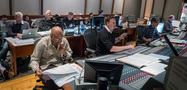 The music team on <i>A Wrinkle in Time</i>: (front row) music librarian Booker White, orchestrator Stephen Coleman, and recording mixer Tom Hardisty; (back row) Director of Music Production at Walt Disney Studios Ryan Hopman, music editor Julie Pearce, music editor Carl Kaller, and ProTools recordist Larry Mah