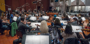 The orchestra records a cue with composer/conductor Ramin Djawadi