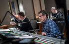 Orchestrator Stephen Coleman gives feedback from the booth while recording mixer Tom Hardisty looks over his score