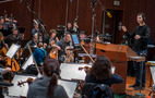 Composer Ramin Djawadi conducts the strings