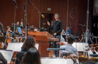 Composer/conductor Ramin Djawadi and the orchestra record