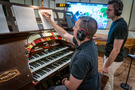 Organist Aaron Shows makes a change to the score as organ consultant Mark Herman observes