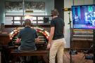 Aaron Shows plays the organ while organ consultant Mark Herman watches, at Bandrika Studios