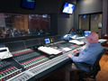 Scoring mixer John Whynot checks the levels
