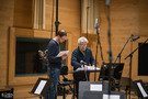 Recording Engineer Patrick Lemmens & Conductor Natale Massara going over the score for <em>Domino</em>