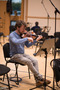 Violin player preparing for the recording