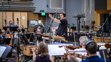 Composer and conductor David Newman cues the orchestra