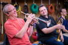 Trumpet player Jon Lewis has a laugh as colleague Rob Shaer looks on
