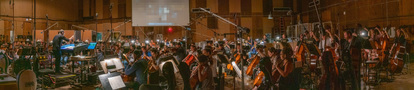 Composer Joseph Trapanese conducts the orchestra as they record his score for <i>Lady and the Tramp</i>