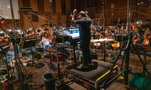 Composer/conductor Joseph Trapanese cues the orchestra