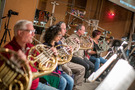 The French horn section records a cue