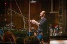 Composer/conductor Joseph Trapanese conducting his score