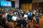The Hollywood Studio Symphony records a cue with conductor/lead orchestrator Tim Davies