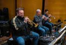 Rob Schaer, Jon Lewis, and Barry Perkins perform on trumpet