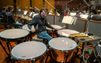 Percussionist Greg Goodall performs on timpani