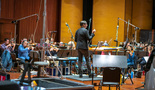 Lead orchestrator Tim Davies conducts the Hollywood Studio Symphony