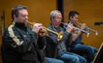 Trumpet players Rob Schaer, Jon Lewis, and Barry Perkins perform